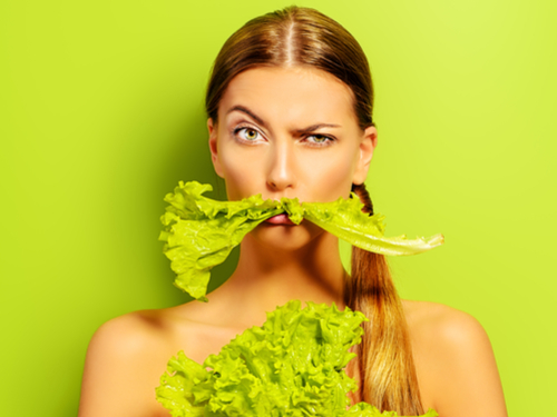 Picture of woman with lettuce in her mouth