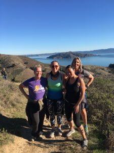 Picture of Scenic Fit members on a trail run above Golden Gate Bridge