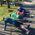Picture of Scenic Fit members holding a plank in the museum area of GG Park